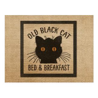 Desayuno viejo de la cama del gato negro de la tarjetas postales