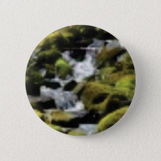Descending moss button
