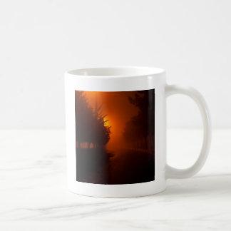 Descenso de rocío de la puesta del sol taza
