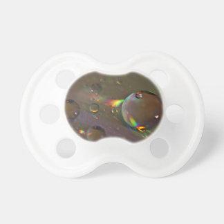 Descensos del agua del color del arco iris chupetes para bebes