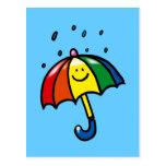 Descensos del paraguas y de la lluvia del arco iri tarjeta postal