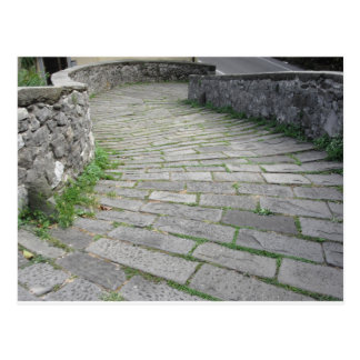 Descent stone walkway of medieval bridge known as postcard