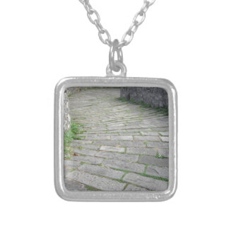 Descent stone walkway of medieval bridge known as silver plated necklace
