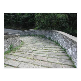 Descent stone walkway of medieval bridge postcard