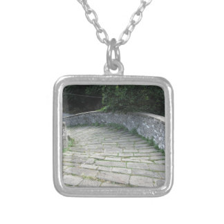 Descent stone walkway of medieval bridge silver plated necklace