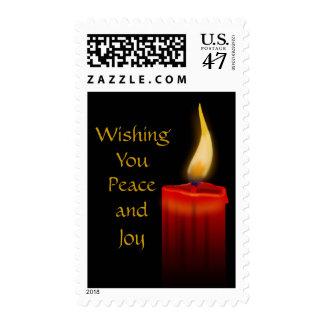 Deseándole paz y alegría vela roja del navidad del sello postal