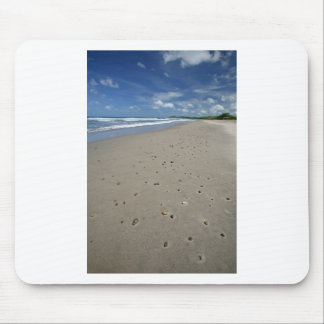 Deserted sandy beach mousepads