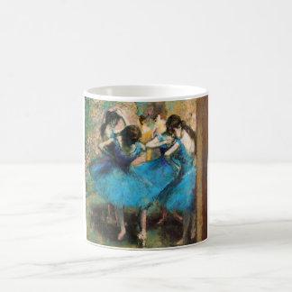 Desgasifique la taza azul de los bailarines