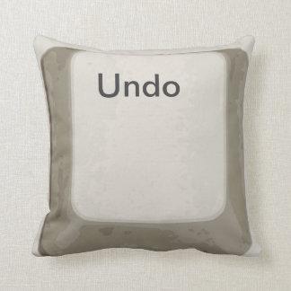 Deshaga el botón/la almohada blanca/gris de la