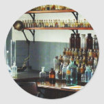 Desk With Bottles of Chemicals Classic Round Sticker