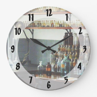 Desk With Bottles of Chemicals Wall Clocks