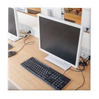 Desktop computer in computer class on school tile