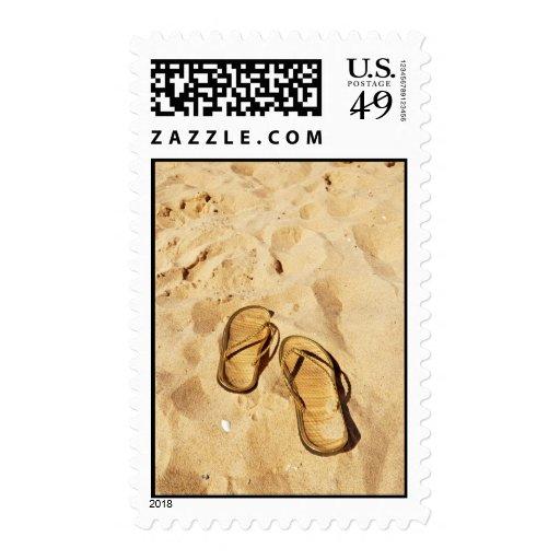 deslizadores de oro en la playa estampillas