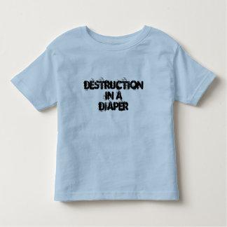 Destrucción en una camisa del niño pequeño del