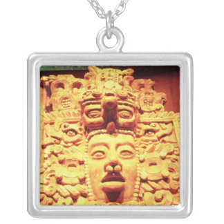 Detail from a temple wall with silver plated necklace