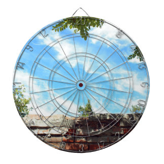 Detail of a blue sky with clouds dartboard with darts