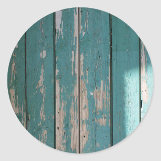 Detail of a green fence from wooden planks classic round sticker
