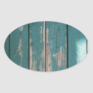 Detail of a green fence from wooden planks oval sticker