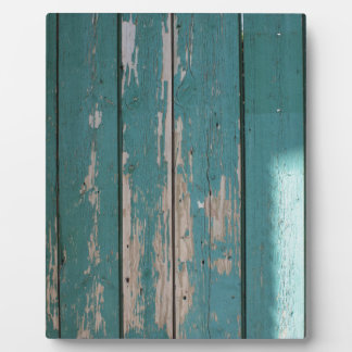 Detail of a green fence from wooden planks plaque