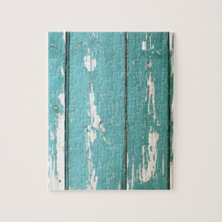 Detail of a green fence from wooden planks puzzles