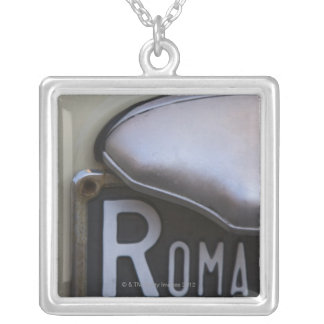 detail of a Roma number plate on a small Italian Custom Jewelry