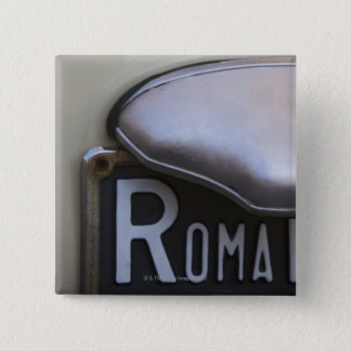 detail of a Roma number plate on a small Italian Pinback Button