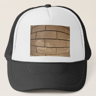 Detail of a wall covered with cement trucker hat