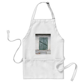 Detail of a wall of an old house with a window adult apron