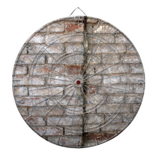 Detail of a wall of an old red brick with white co dart board