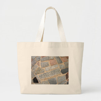 Detail of a wall of marble blocks large tote bag