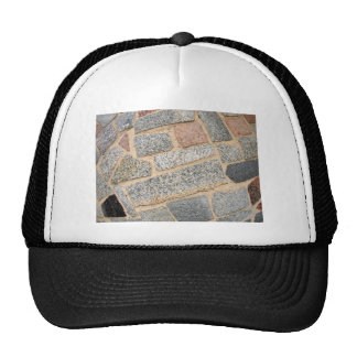 Detail of a wall of marble blocks trucker hat