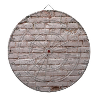 Detail of a wall of the old beige clay bricks dartboard with darts