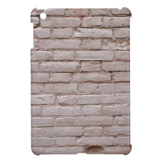Detail of a wall of the old beige clay bricks iPad mini covers