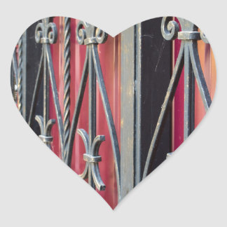 Detail of an old iron fence heart sticker