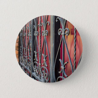 Detail of an old iron fence pinback button