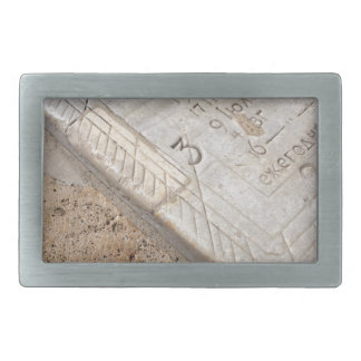 Detail of ancient stone dial sundial closeup belt buckle