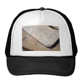 Detail of ancient stone dial sundial closeup trucker hat