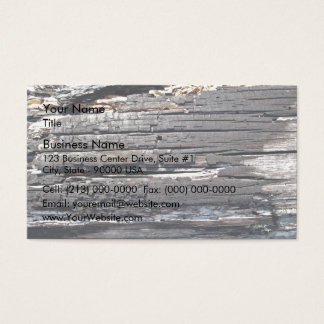 Detail of burnt wooden log with damaged surface business card