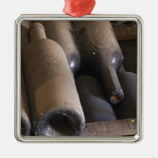 Detail of dusty bottles sur lattes on wooden metal ornament