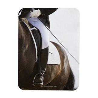 detail of female dressage rider on horse rectangular photo magnet