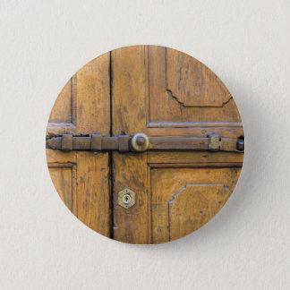 detail of old wooden door button