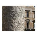 detail of Trajan's Column with buildings behind Postcard