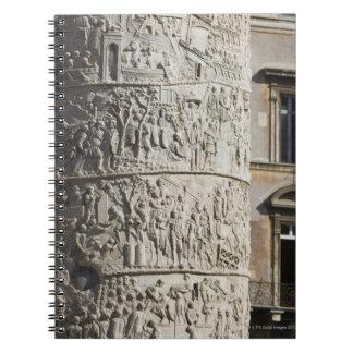 detail of Trajan's Column with buildings behind Spiral Notebook