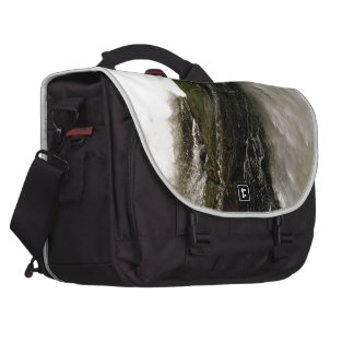 DETAIL OF WATERFALL OVER MOSSY BOULDER LAPTOP BAGS