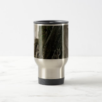 DETAIL OF WATERFALL OVER MOSSY BOULDER TRAVEL MUG