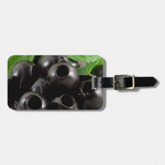 Detailed close-up view of the black olives luggage tag