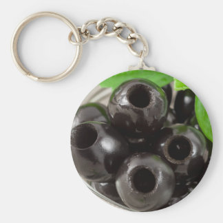 Detailed macro view of the black olives keychain
