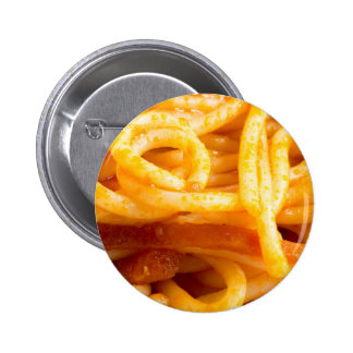 Detailed macro view on cooked spaghetti on a plate pinback button