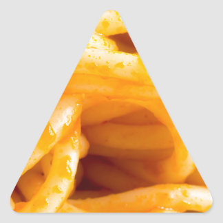 Detailed macro view on cooked spaghetti on a plate triangle sticker