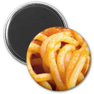 Detailed macro view on cooked spaghetti with sauce magnet